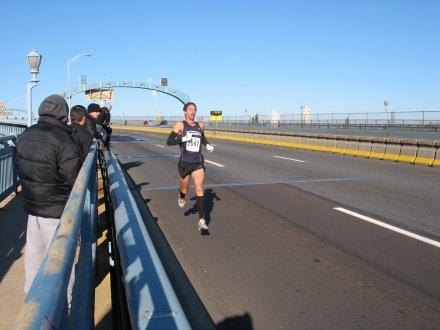 Coach Marc racing down the Ben Franklin Bridge